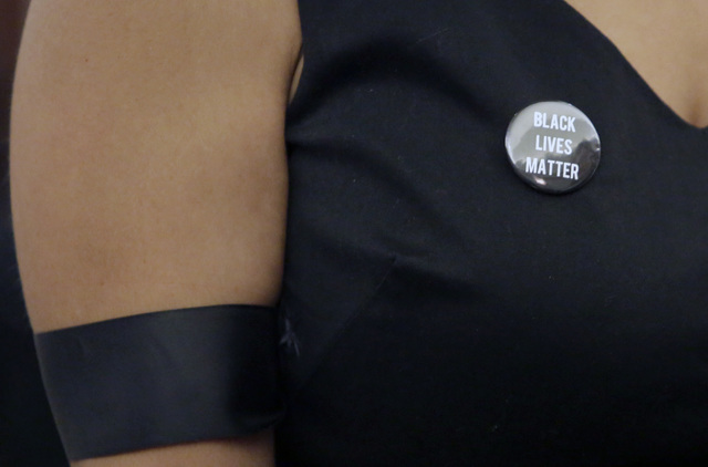 Erika Ballou, a deputy public defender in Clark County, wears a Black Lives Matter button and black ribbon inside a courtroom Thursday, Sept. 22, 2016, at  the Regional Justice Center in Las Vegas ...