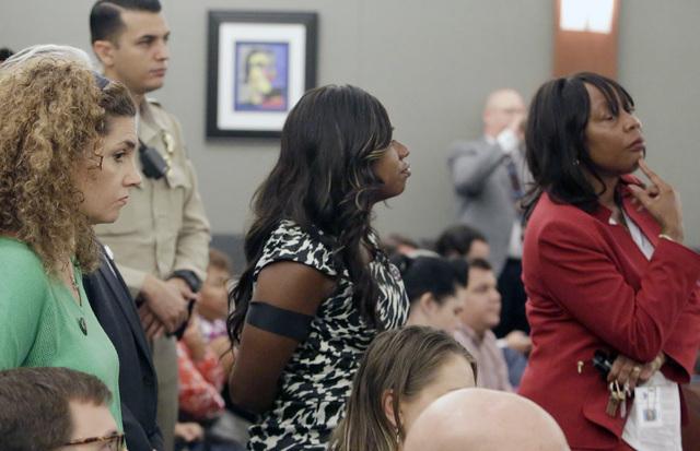 Public defenders, including Belinda Harris, center, wearing a Black Lives Matter button, listen as Erika Ballou, not photographed, presents her argument Thursday, Sept. 22, 2016, at the Regional J ...