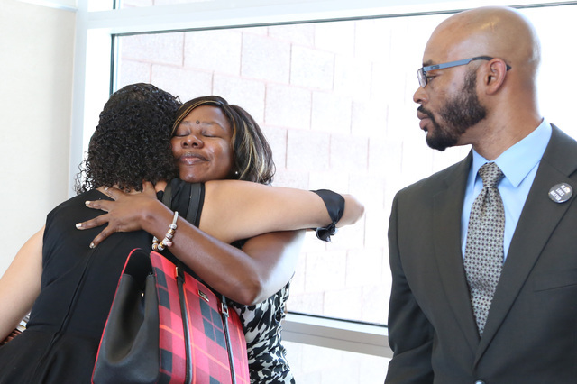 Erika Ballou, left, is embraced by Belinda Harris as she leaves the courtroom after being told by District Judge Douglas Herndon not to wear a Black Lives Matter pin inside the courtroom as Jonath ...