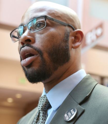 Jonathan MacArthur talks to reporters about Distict Judge Douglas Herndon's decision not to allow attorneys to wear Black Lives Matter pins in the courtroom on Thursday, Sept. 22, 2016, at the Reg ...
