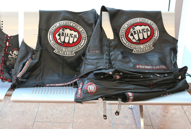 """Leather jackets with a """"Bikers Against Child Abuse"""" emblem are shown on a bench outside the courtroom after people were told not to wear them inside the courtroom on Thursday, Sept. 22, 2016, at t ..."""