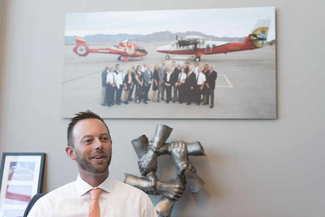 Geoff Edlund, president of Papillon Grand Canyon Helicopters, speaks with a reporter prior to a ribbon cutting ceremony for the company's new Hoover Dam heliport in Boulder City, Thursday, Sept. 8 ...