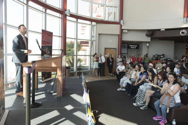 At Boulder City Municipal Airport, Geoff Edlund, president of Papillon Grand Canyon Helicopters, speaks during a ribbon cutting ceremony for the company's new Hoover Dam heliport in Boulder City,  ...