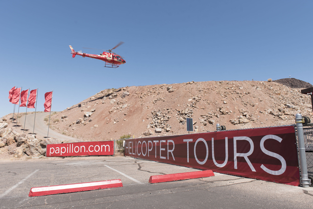 A tour group returns to Papillon Grand Canyon Helicopters' new Hoover Dam helipad located adjacent to Hoover Dam Lodge hotel-casino in Boulder City, Thursday, Sept. 8, 2016. Jason Ogulnik/Las Vega ...