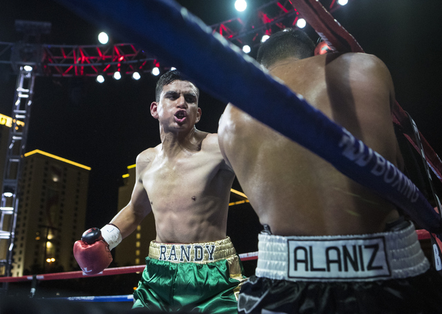 """Randy Moreno, left, goes for a punch against Fabian """"El Suavecito"""" Alaniz during the Knockout Night at the D Las Vegas on Friday, Sept. 30, 2016.  (Loren Townsley/Las Vegas Review-Journal) Follow  ..."""