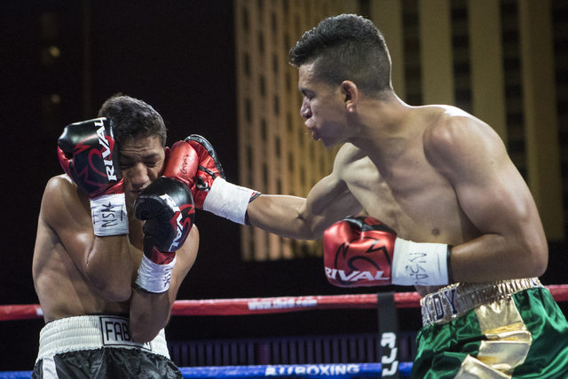 """Randy Moreno, right, goes for a punch against Fabian """"El Suavecito"""" Alaniz during the Knockout Night at the D Las Vegas on Friday, Sept. 30, 2016.  (Loren Townsley/Las Vegas Review-Journal) Follow ..."""