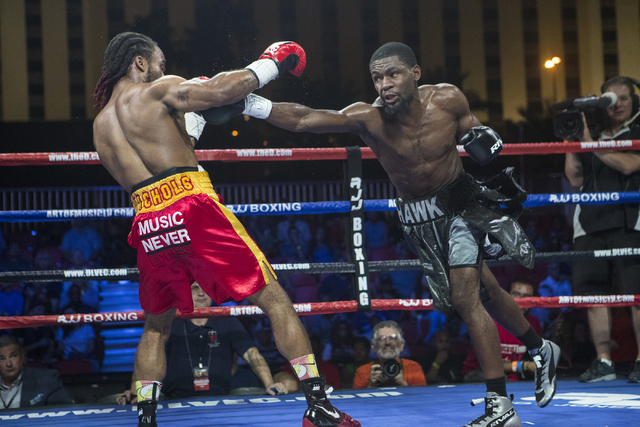 """Marquis """"The Hawk"""" Hawthorn, right, connects with Jeremy """"J-Flash"""" Nichols during the Knockout Night at the D Las Vegas on Friday, Sept. 30, 2016.  (Loren Townsley/Las Vegas Review-Journal) Follow ..."""