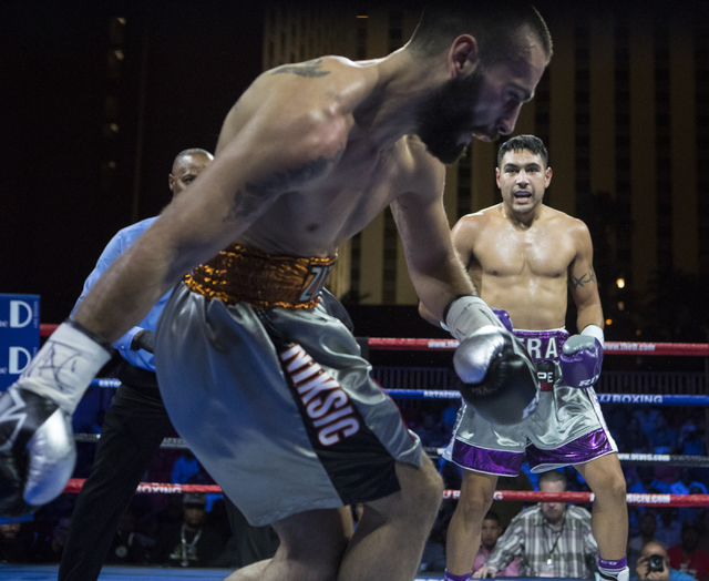"""Milorad """"Micko"""" Zizic, left, looses balance after John """"The Phenom"""" Vera lands a punch during the Knockout Night at the D Las Vegas on Friday, Sept. 30, 2016.  (Loren Townsley/Las Vegas Review-Jou ..."""