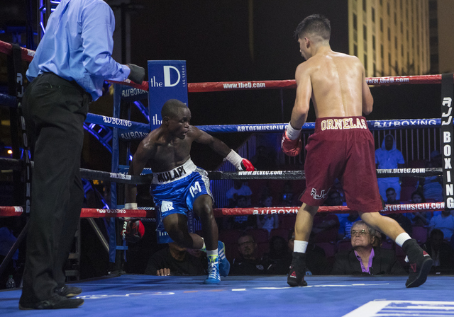"""Mulapi Enjani, center, hurts his leg after Max """"The Baby Faced Assassin"""" Ornelas lands a punch during the Knockout Night at the D Las Vegas on Friday, Sept. 30, 2016.  (Loren Townsley/Las Vegas Re ..."""