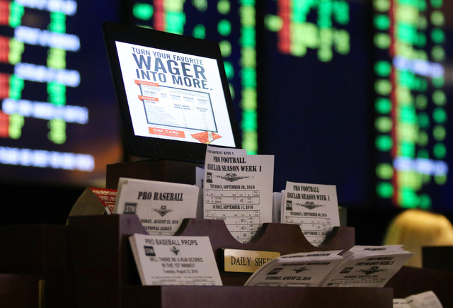 Sports line sheets are shown in the newly renovated sports side of the Race & Sports Book at Palace Station hotel-casino Tuesday, Aug. 23, 2016, in Las Vegas.  (Ronda Churchill/Las Vegas Revie ...