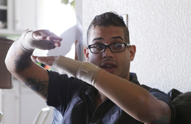 Christopher Erle, who suffered a brain injury several years ago, speaks during an interview at his North Las Vegas home on Thursday, Aug. 11, 2016. Erle, who barely spoke after the incident, is no ...