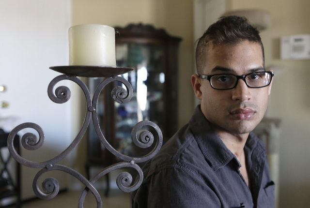 Christopher Erle who suffered a brain injury several years ago poses at his North Las Vegas home on Thursday, Aug. 11, 2016. Erle who barely spoke after the incident, is now speaking, healing and  ...