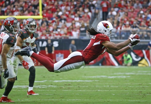 Arizona wide receiver Larry Fitzgerald jumps to make a reception against Tampa Bay in the second half Sunday, Sept. 18, 2016 in Glendale  Ariz. (David Kadlubowski/The Republic via AP)