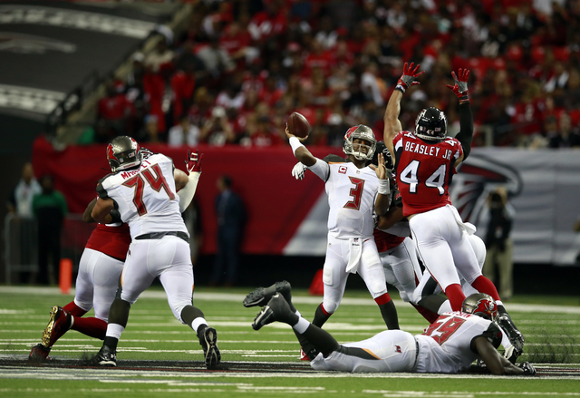 Tampa Bay Buccaneers quarterback Jameis Winston (3) looks to throw a pass during an NFL football game against the Atlanta Falcons, Sunday, Sept. 11, 2016, in Atlanta. The Buccaneers won the game 3 ...