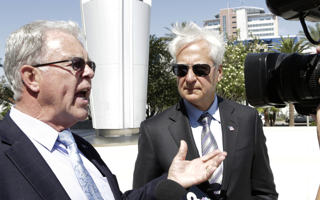 Cliven Bundy's attorney, Joel Hansen, left, and Washington, D.C., attorney Larry Klayman, right, address the media outside the Lloyd George U.S. Courthouse on Wednesday, May 25, 2016. (Bizuayehu T ...