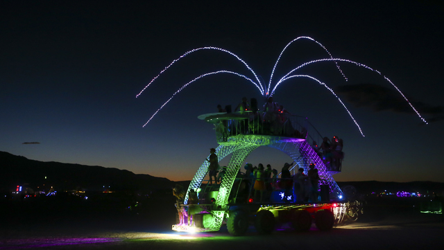 People dance in a moving art car during Burning Man at the Black Rock Desert north of Reno on Tuesday, Aug. 30, 2016. Chase Stevens/Las Vegas Review-Journal Follow @csstevensphoto