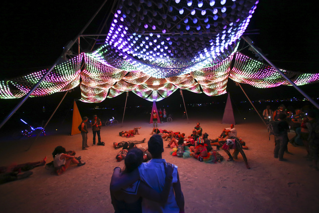 Brandi DeCarli, left, and Tim Wegman take in an art installation during Burning Man at the Black Rock Desert north of Reno on Tuesday, Aug. 30, 2016. Chase Stevens/Las Vegas Review-Journal Follow  ...