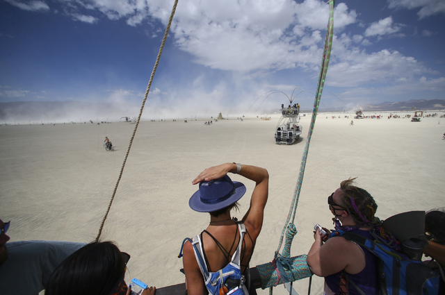 Kristen Whoriskey of Boston, center, looks out at the playa from the USS Nevada art car during an art tour as Burning Man goes on in the Black Rock Desert north of Reno on Wednesday, Aug. 31, 2016 ...