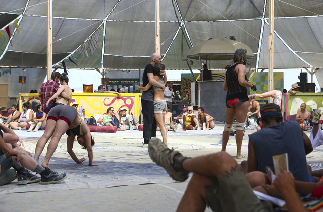 Attendees relax and do yoga at the center camp cafe during Burning Man at the Black Rock Desert north of Reno on Wednesday, Aug. 31, 2016. Chase Stevens/Las Vegas Review-Journal Follow @csstevensphoto