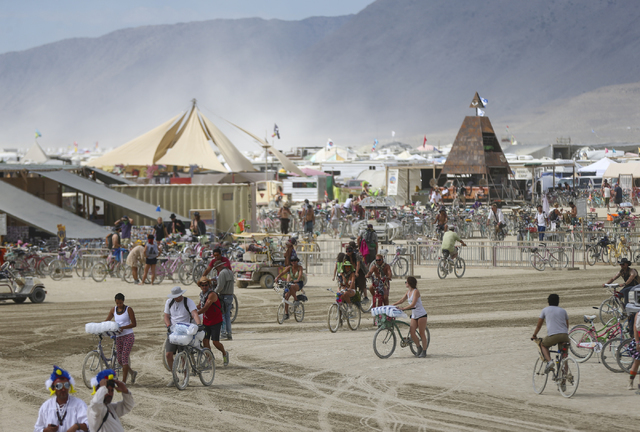 Attendees bike around the center camp at Burning Man at the Black Rock Desert north of Reno on Wednesday, Aug. 31, 2016. Chase Stevens/Las Vegas Review-Journal Follow @csstevensphoto