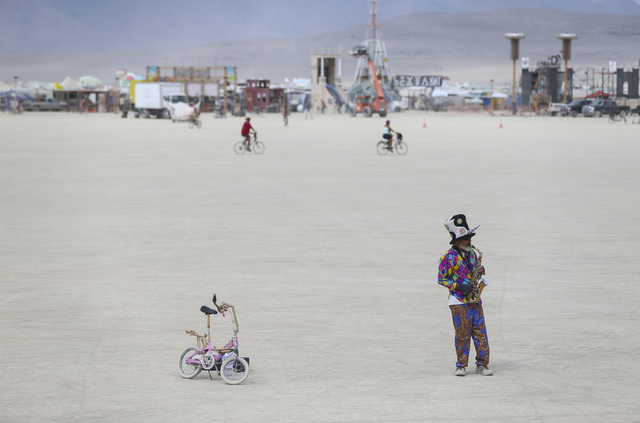 "Al Barney, also known as ""Captain Drift,"" plays saxophone on the playa during Burning Man at the Black Rock Desert north of Reno on Wednesday, Aug. 31, 2016. Chase Stevens/Las Ve ..."