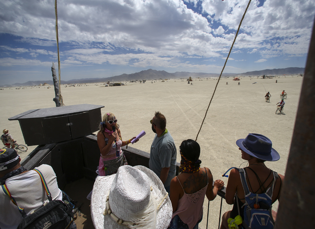 """Dazzle!,"" her playa name, leads an art tour aboard an art car, the USS Nevada, during Burning Man at the Black Rock Desert north of Reno on Wednesday, Aug. 31, 2016. Chase Steve ..."