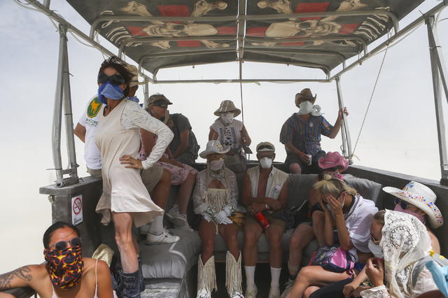 Attendees aboard the USS Nevada art car look on as a dust storm passes through during Burning Man at the Black Rock Desert north of Reno on Wednesday, Aug. 31, 2016. Chase Stevens/Las Vegas Review ...