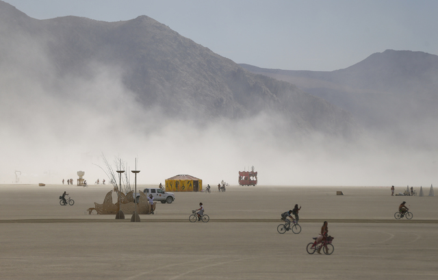 Attendees roam the deep playa during Burning Man at the Black Rock Desert north of Reno on Wednesday, Aug. 31, 2016. Chase Stevens/Las Vegas Review-Journal Follow @csstevensphoto