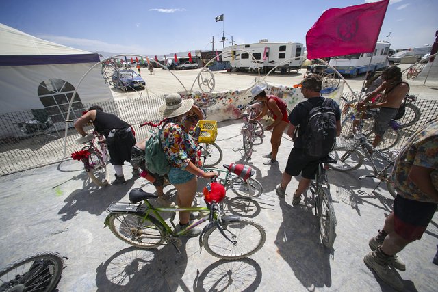 Attendees modify and decorate their bikes at the bicycle mutation station during Burning Man at the Black Rock Desert north of Reno on Wednesday, Aug. 31, 2016. Chase Stevens/Las Vegas Review-Jour ...