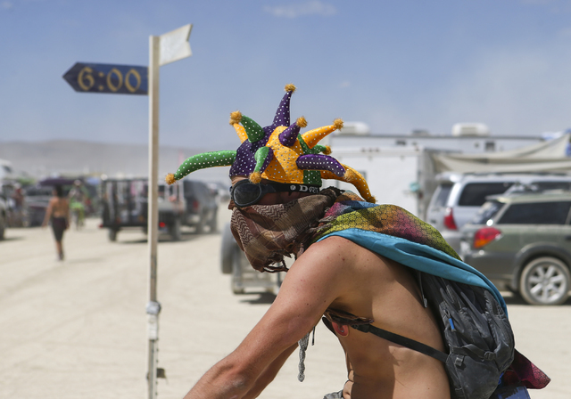 A man passes by during Burning Man at the Black Rock Desert north of Reno on Wednesday, Aug. 31, 2016. Chase Stevens/Las Vegas Review-Journal Follow @csstevensphoto