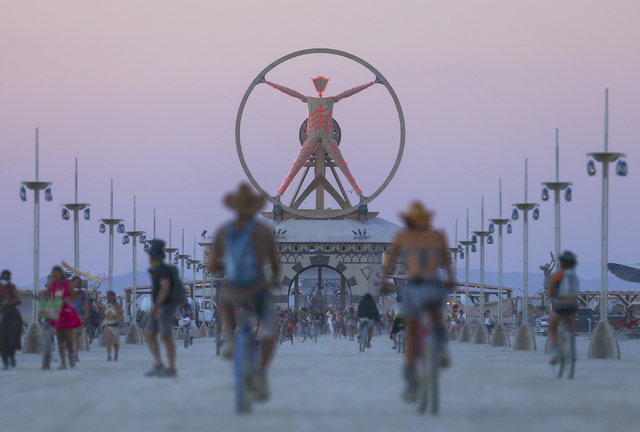 The Burning Man effigy, modeled after the Leonardo da Vinci's Vitruvian Man, stands above the playa during Burning Man at the Black Rock Desert north of Reno on Wednesday, Aug. 31, 2016. Chase Ste ...