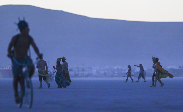 Attendees walk and bike on the playa during Burning Man at the Black Rock Desert north of Reno on Wednesday, Aug. 31, 2016. Chase Stevens/Las Vegas Review-Journal Follow @csstevensphoto
