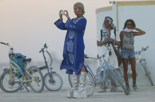 A woman takes a photo during Burning Man at the Black Rock Desert north of Reno on Wednesday, Aug. 31, 2016. Chase Stevens/Las Vegas Review-Journal Follow @csstevensphoto