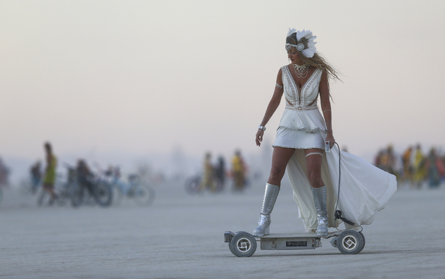 A woman rides an electric scooter during Burning Man at the Black Rock Desert north of Reno on Wednesday, Aug. 31, 2016. Chase Stevens/Las Vegas Review-Journal Follow @csstevensphoto