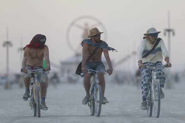 Attendees ride bikes on the playa during Burning Man at the Black Rock Desert north of Reno on Wednesday, Aug. 31, 2016. Chase Stevens/Las Vegas Review-Journal Follow @csstevensphoto