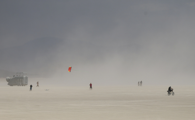 A man flies a kite on the playa during Burning Man at the Black Rock Desert north of Reno on Wednesday, Aug. 31, 2016. Chase Stevens/Las Vegas Review-Journal Follow @csstevensphoto