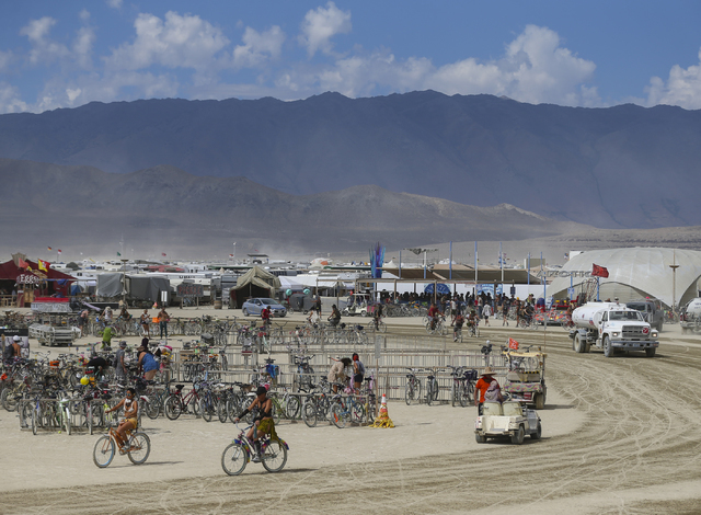 Attendees pass through the center camp area during Burning Man at the Black Rock Desert north of Reno on Wednesday, Aug. 31, 2016. Chase Stevens/Las Vegas Review-Journal Follow @csstevensphoto