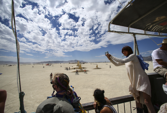 Attendees aboard the USS Nevada art car taken the sights during Burning Man at the Black Rock Desert north of Reno on Wednesday, Aug. 31, 2016. Chase Stevens/Las Vegas Review-Journal Follow @csste ...