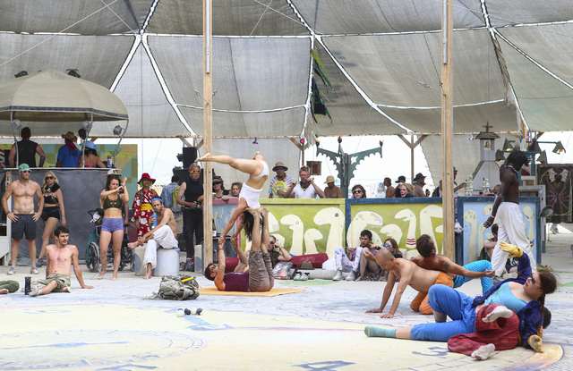 Attendees do yoga at the center camp cafe during Burning Man at the Black Rock Desert north of Reno on Wednesday, Aug. 31, 2016. Chase Stevens/Las Vegas Review-Journal Follow @csstevensphoto
