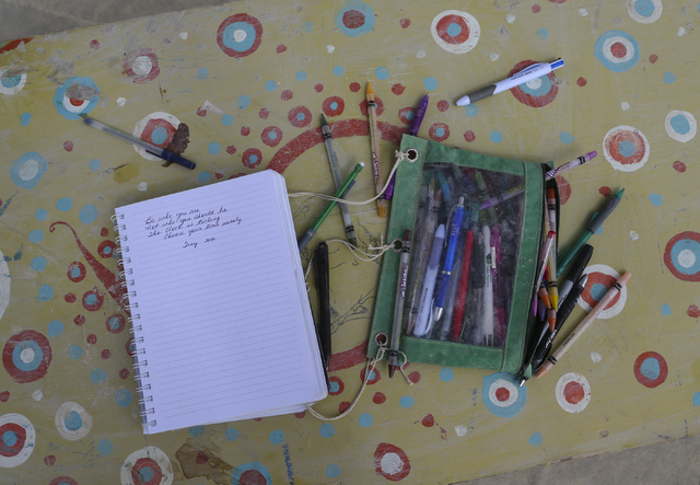 A notebook with pencils sit alone on a table at the center camp cafe during Burning Man at the Black Rock Desert north of Reno on Wednesday, Aug. 31, 2016. Chase Stevens/Las Vegas Review-Journal F ...