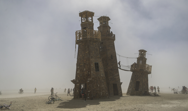 Attendees explore The Black Rock Lighthouse Service art installation during Burning Man at the Black Rock Desert north of Reno on Thursday, Sept. 1, 2016. Chase Stevens/Las Vegas Review-Journal Fo ...