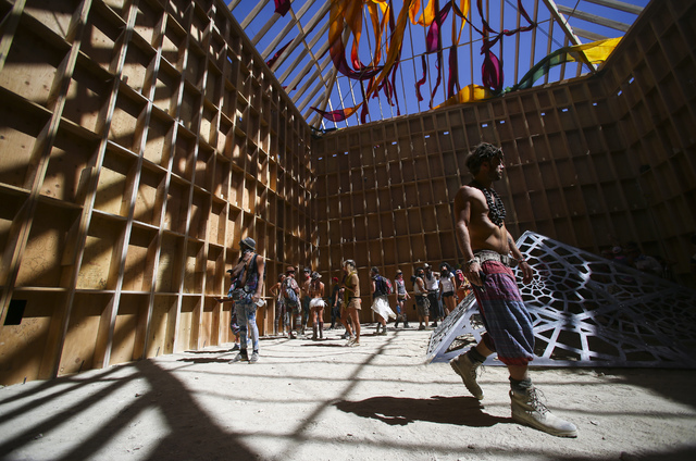 Attendees explore the Catacomb of Veils art installation during Burning Man at the Black Rock Desert north of Reno on Thursday, Sept. 1, 2016. Chase Stevens/Las Vegas Review-Journal Follow @csstev ...