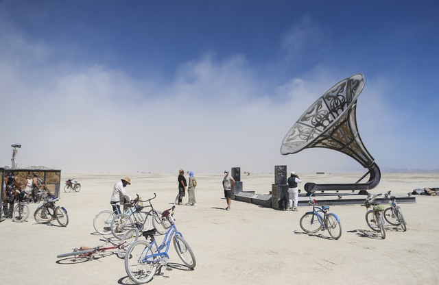 Attendees take in an art installation during Burning Man at the Black Rock Desert north of Reno on Thursday, Sept. 1, 2016. Chase Stevens/Las Vegas Review-Journal Follow @csstevensphoto