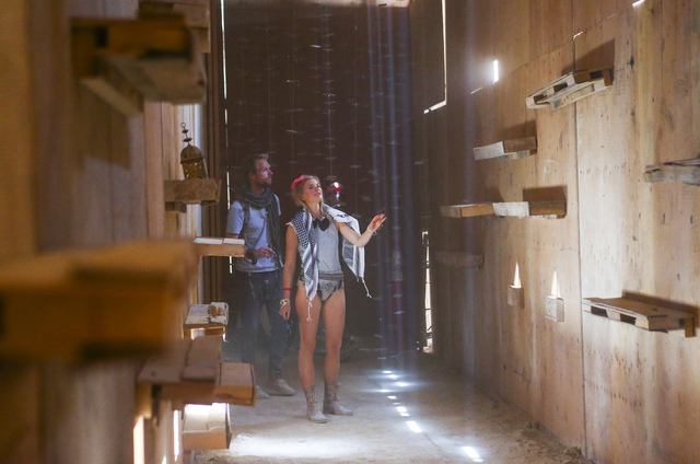 Livia Hangen and Hendrik Knoop, both of Germany, explore the Catacomb of Veils art installation during Burning Man at the Black Rock Desert north of Reno on Thursday, Sept. 1, 2016. Chase Stevens/ ...