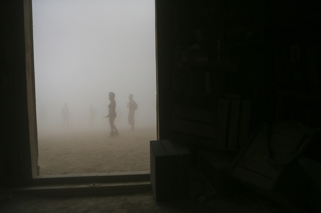 Attendees are silhouetted as a dust storm moves along the playa during Burning Man at the Black Rock Desert north of Reno on Thursday, Sept. 1, 2016. Chase Stevens/Las Vegas Review-Journal Follow  ...