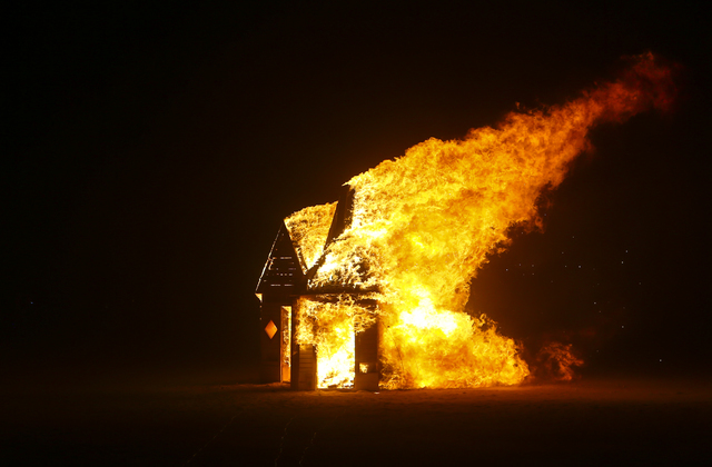 Art installation Jedi Dog Temple, created by 5-year-old Sagan Bocskor of Las Vegas, burns during Burning Man at the Black Rock Desert north of Reno on Thursday, Sept. 1, 2016. (Chase Stevens/Las V ...