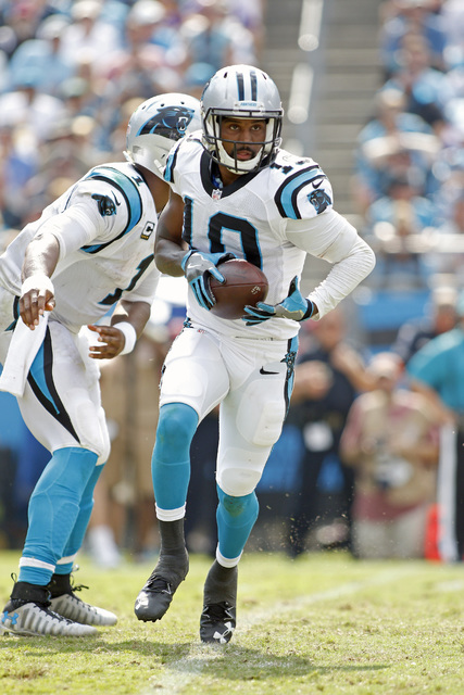 Carolina Panthers' Corey Brown (10) looks to hand the ball off against the Minnesota Vikings after he got a hand-off from Cam Newton (1) during the second half of an NFL football game in Charlotte ...