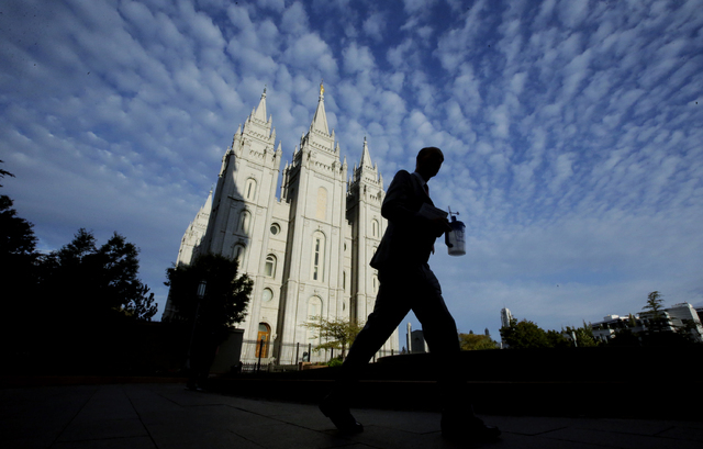 A man walks past the Salt Lake Temple,  a temple of The Church of Jesus Christ of Latter-day Saints, at Temple Square, Wednesday, Sept. 14, 2016, in Salt Lake City. (Rick Bowmer/The Associated Press)