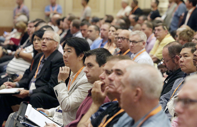 Attendees listen as James Taylor, deputy chief of special investigations for the Nevada State Gaming Control Board, presents current and ongoing fraud schemes and current trends in casino crimes M ...