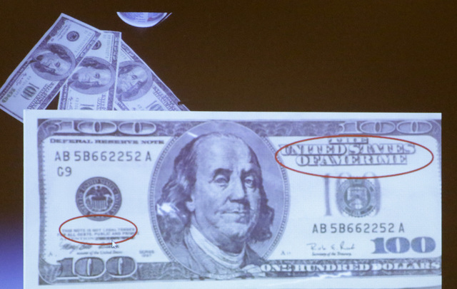 A counterfeit $100 bill is displayed as James Taylor, deputy chief for the Nevada State Gaming Control Board, presents current and ongoing fraud schemes and current trends in casino crimes Monday, ...